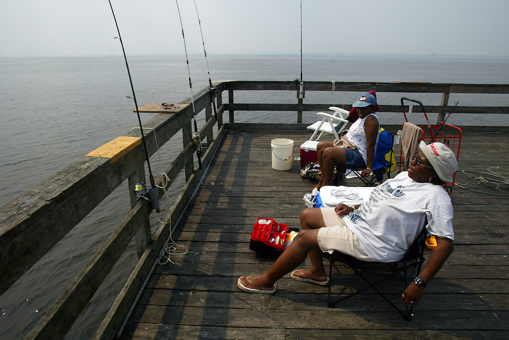 (DAYIN) Keansburg 7/3/2002  Joyce Watson and Suzanne Kane both of Newark, who are also teachers off for the summer try to beat the heat and catch some fish at the very end of the 2400 foot Keansburg Fishing Pier.       Michael J. Treola Staff Photographer.............MJT