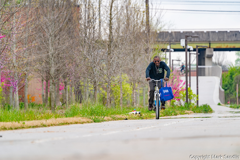 Westside Beltline runs behind homes, industrial parks and old warehouses sprouting business.