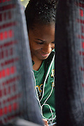 April 4, 2016; Indianapolis, Ind.; Christina Davis listens to music on the team bus before their game against Lubbock Christian in the NCAA Division II Women's Basketball National Championship game at Bankers Life Fieldhouse.