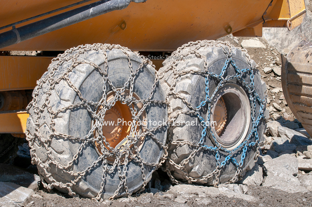 Heavy Earth moving equipment with snow chains on its tyres. Photographed at Stubaier Wildspitze Tyrol, Austria