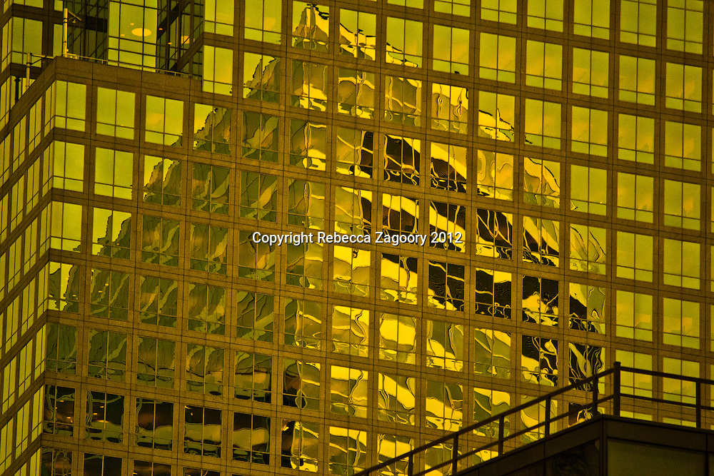 Liquid Gold - Goldman Saks building reflected in the American Express Building. The two titans of Wall Street make up Liquid Gold.