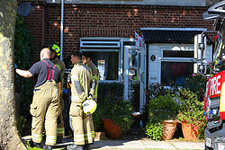 © Licensed to London News Pictures. 06/09/2020. London, UK. Fire crew outside a property on The Link, Enfield in north London were a woman died following a house fire. London Fire Brigade was called to the scene at 2.19am early this morning. Firefighters wearing breathing apparatus bought a woman out of the property and she was pronounced dead at the scene. The fire is under investigation. Photo credit: Dinendra Haria/LNP