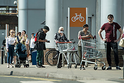 © Licensed to London News Pictures. 10/04/2020. London, UK. People queue at Sainsbury's supermarket on Ladbroke Grove in London, during a pandemic outbreak of the Coronavirus COVID-19 disease. The public have been told they can only leave their homes when absolutely essential, in an attempt to fight the spread of coronavirus COVID-19 disease. Photo credit: Ben Cawthra/LNP