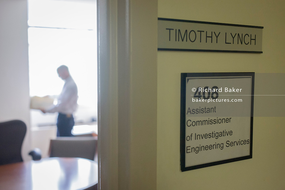 Investigative Engineering Services, Assistant Commissioner Tim Lynch in his federal office on Broadway.