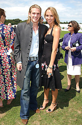 MR JACOBI ANSTRUTHER-GOUGH-CALTHORPE and MISS SKYE GOWRIE-SMITH at the 2004 Cartier International polo day at Guards Polo Club, Windsor Great Park, Berkshire on 25th July 2004.