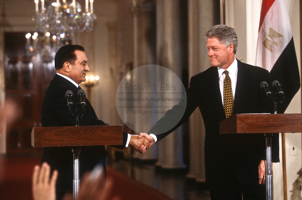 President Bill Clinton shakes hands with visiting Egyptian President Hosni Mubarak after a joint news conference March 10, 1997 in the White House East Room.