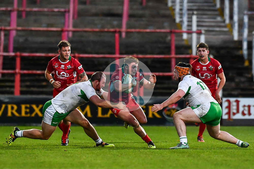 11th November 2018 , Racecourse Ground,  Wrexham, Wales ;  Rugby League World Cup Qualifier,Wales v Ireland ; Curtis Davies of Wales is tackled by George King of Ireland <br /> <br /> <br /> Credit:   Craig Thomas/Replay Images