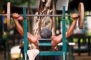 A man weightlifting at Lumpini Park in bangkok, Thailand