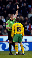 Photo: Jed Wee.<br />Sheffield United v Norwich City. Coca Cola Championship.<br />26/12/2005.<br />Norwich's Paul McVeigh (R) receives a yellow card from referee T Kettle after celebrating in front of the Sheffield fans.