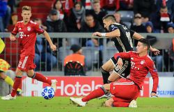 02.10.2018, CL, Champions League, FC Bayern Muenchen vs Ajax Amsterdam, Allianz Arena  Muenchen, im Bild:...Joshua Kimmich (FCB), und Dusan Tadic ( Ajax Amsterdam) vs James Rodriguez (FCB)..DFL REGULATIONS PROHIBIT ANY USE OF PHOTOGRAPHS AS IMAGE SEQUENCES AND / OR QUASI VIDEO...Copyright: Philippe Ruiz..Tel: 089 745 82 22.Handy: 0177 29 39 408.e-Mail: philippe_ruiz@gmx.de. (Credit Image: © Philippe Ruiz/Xinhua via ZUMA Wire)