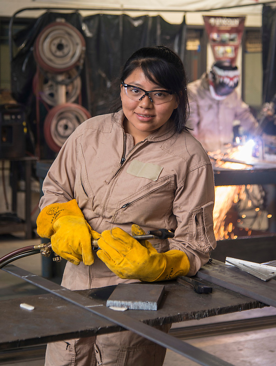 Northside High School student Dora Lopez poses for a photograph in a welding class at the Barbara Jordan High School for Careers, November 21, 2016.