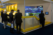 Delegates watch PR films at the electronics company Elbit Systems UK's trade stand during the Farnborough Air Show, UK.