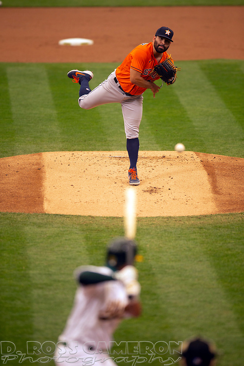 Sep 10, 2020; Oakland, California, USA; Houston Astros starting pitcher Jose Urquidy (65) delivers a pitch against the Oakland Athletics during the first inning of a baseball game at Oakland Coliseum. Mandatory Credit: D. Ross Cameron-USA TODAY Sports
