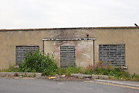 Derelict building with bricked up windows and door in Dun Laoghaire, Dublin, Ireland