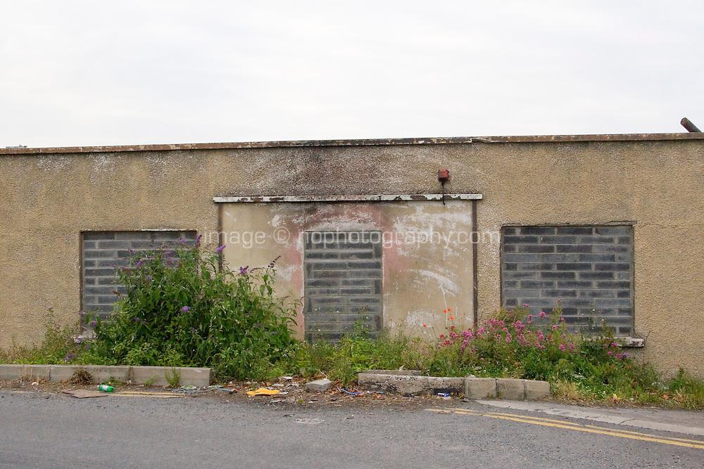 Derelict building with bricked up windows and door in Dun Laoghaire, Dublin, Ireland