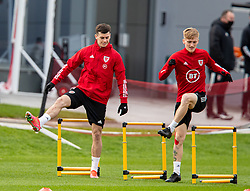 CARDIFF, WALES - Monday, March 29, 2021: Wales' Tom Lawrence (L) and Matthew Smith during a training session at the Vale Resort ahead of the FIFA World Cup Qatar 2022 Qualifying Group E game against the Czech Republic. (Pic by David Rawcliffe/Propaganda)