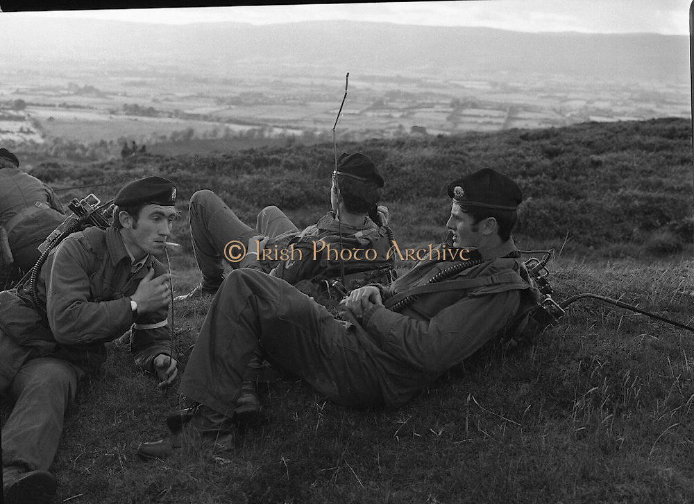 """Army Exercises In Co Sligo.   (L37).<br /> 1977.<br /> 05.09.1977.<br /> 09.05.1977.<br /> 5th September 1977.<br /> The Army Reserve Brigade, which is made up of regular units from the Southern Command, are conducting a series of conventional military exercises in counties Mayo and Sligo from the 5th to the 9th September. Approximately 1,500 men and 250 vehicles are involved. The exercise was codenamed """"Humbert"""" after an ill fated expedition by French troops into Ireland on 23rd August 1798. 1,100 French troops with Irish support took on the incumbent English forces. After some initial success they were defeated at Ballinamuk on 8th Sept 1798 by the army of Cornwallis.<br /> <br /> The signals team take a break for some rest and recuperation during the exercises."""