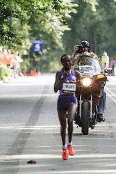 NYRR Oakley Mini 10K for Women: Victah Sailer on motorcycle photographs winner 31:15 Mary Keitany, Kenya, adidas