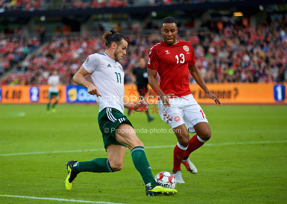 AARHUS, DENMARK - Sunday, September 9, 2018: Wales' captain Gareth Bale (left) and Denmark's Mathias Jørgensen (right) during the UEFA Nations League Group Stage League B Group 4 match between Denmark and Wales at the Aarhus Stadion. (Pic by David Rawcliffe/Propaganda)