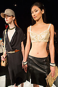 A detailed bra top with short black slitted skirt, and a black dress with wrap top. By Monika Chiang at Spring 2013 Fashion Week in New York.