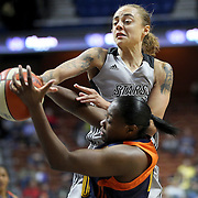 UNCASVILLE, CONNECTICUT- MAY 05:  Jazmon Gwathmey #24, (top), of the San Antonio Stars and Shekinna Stricklen #40 of the Connecticut Sun challenge for a rebound during the San Antonio Stars Vs Connecticut Sun preseason WNBA game at Mohegan Sun Arena on May 05, 2016 in Uncasville, Connecticut. (Photo by Tim Clayton/Corbis via Getty Images)