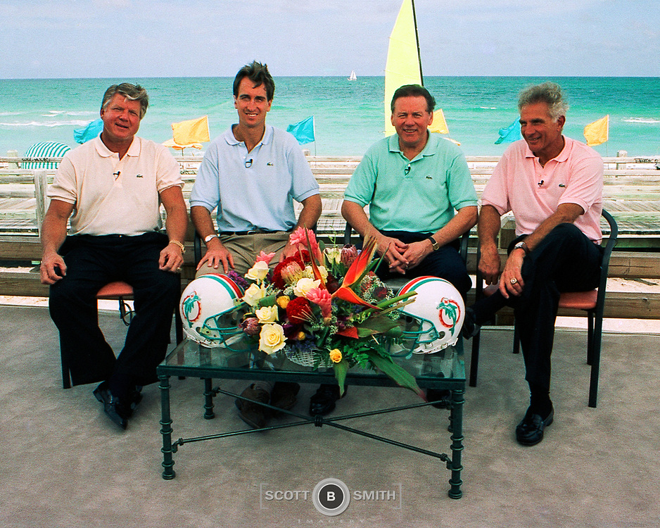 Former coach Jimmy Johnson, former receiver Cris Collinsworth, former quaterback Len Dawson and former linebacker Nick Buoniconti on location at the Eden Roc Resort, Miami Beach, for HBO's Inside the NFL program.  The broadcast took place on the deck of Coach Johnson's newly opened Three Rings Bar and Grill, January 1995.