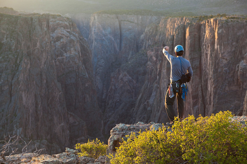 Obadiah Reid looks out towards The Narrows from Island Peaks at sunset in Black Canyon of the Gunnison National Park, Colorado.