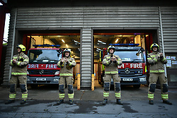 © Licensed to London News Pictures. 30/04/2020. London, UK. Firefighters form North Kensington Fire Station in Notting Hill take part in 'Clap For Our Carers' by applauding NHS workers, carers and key workers. British Prime Minister Boris Johnson, who retuned to Downing Street on Monday, has warned the public against relaxing lockdown precautions too soon. Photo credit: Ben Cawthra/LNP