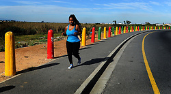 SOUTH AFRICA - Cape Town - 01 May 2020 - Lindokuhle Mzila jogging in Wesbank as South Africa has entered into the first day of level four lockdown. In late March, the country entered into lockdown in a bid to stop the spread of the coronavirus. Some restrictions will be relaxed during level four of the lockdown regulation. Picture:Brendan Magaar/African News Agency (ANA)