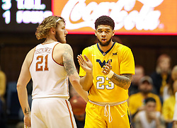 Jan 20, 2018; Morgantown, WV, USA; West Virginia Mountaineers forward Esa Ahmad (23) celebrates after a basket during the second half against the Texas Longhorns at WVU Coliseum. Mandatory Credit: Ben Queen-USA TODAY Sports