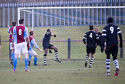 Whitehill Welfare John Halls (2) scoring their goal.<br /> half time : Whitehill Welfare 1 v 1 Edusport Academy, South Challenge Cup Quarter Final played 7/3/2015 at Ferguson Park, Carnethie Street, Rosewell.
