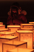 People take part in a candle lit memorial event to remember the victims of the tsunami at Natori City hall, Natori, near Sendai, Miyagi, Japan. Friday March 11th 2016. 2016 marks the fifth anniversary of the Great East Japan earthquake. This magnitude 9 quake caused a tsunami that flattened large parts of the Tohoku coast killing around 18,000 people and caused a nuclear disaster at Fukushima Daichi Power Station.