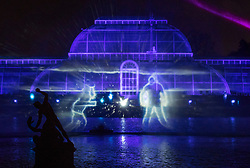 © Licensed to London News Pictures. 21/11/2017. London, UK. Figures projected onto water vapour in front of the Palm House herald the opening of Christmas at Kew at Royal Botanical Gardens, Kew. The spectacular displays are illuminated by over one million tiny twinkling lights placed all over Kew Gardens - open Wednesdays – Sundays from 22 November 2017 – 2 January 2017. London, UK. Photo credit: Peter Macdiarmid/LNP