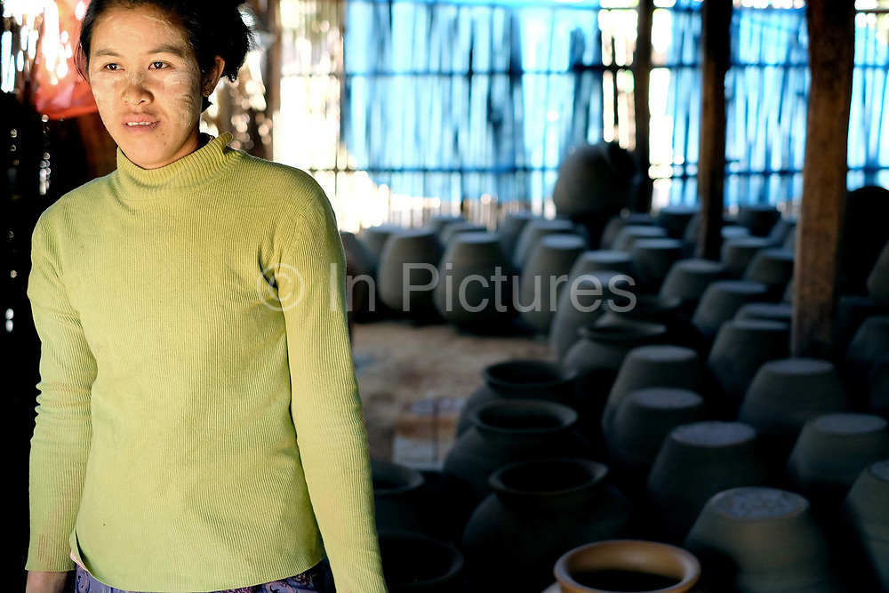 Portrait of a woman in her workshop in Kyauk Daing pottery village on the banks of Inle Lake on 21st January 2016 in Shan State, Myanmar