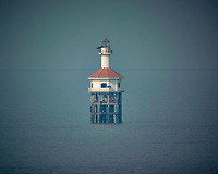 Lighthouse in the middle of Vinh Ganh Rai (Bay) from the deck of the MV World Odyssey. Image taken with a Nikon 1 V3 camera and 70-300 mm VR lens (ISO 200, 300 mm, f/5.6, 1/2000 sec).