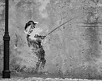 Damaged Fisherman. Art along the Fort Wall. Afternoon Street Photography in Cascias. Image taken with a Nikon 1V3 camera and 70-300 mm VR telephoto zoom lens.