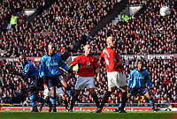 Shaun Goater (left) watches his header as heads towards goal for the Manchester City equaliser. Manchester United v Manchester City, FA Premiership, 8/02/2003. Credit: Matthew Impey Digitalsport