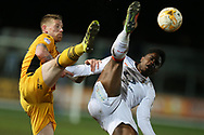 Pelly Ruddock Mpanzu of Luton Town ® is challenged by Scot Bennett of Newport county (l).EFL Skybet football league two match, Newport county v Luton Town at Rodney Parade in Newport, South Wales on Tuesday 21st March 2017.<br /> pic by Andrew Orchard,  Andrew Orchard sports photography.