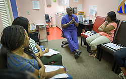 Dr. Willie Parker, councils a group of women who have decided to have an abortion, at the Jackson Women's Health Organization clinic, on Monday August 18, 2014, in Jackson, Mississippi. This is the only clinic in the entire state that performs abortions. (Photo © Jock Fistick)