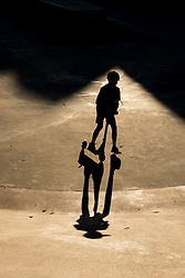 United States, Washington, Seattle, Seattle Center, boy on scooter with shadow