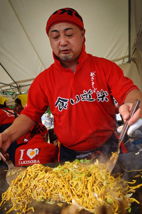 """A yakisoba stall, B1 Grand Prix, Yokote, Akita Pref, Japan, September 19 2009. The B1 Grand Prix is a competition for inexpensive and tasty regional dishes from around Japan. The B stands for """"b-class gourmet"""". In 2009 it was held in the northern Japan city of Yokote."""