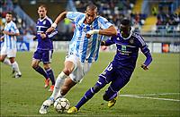Fotball 4. desember 2012 , Champions League Oguchi Onyewu of Malaga - Cheikhou Kouyate of RSC Anderlecht<br /> Malaga - Anderlecht<br /> <br /> Norway only
