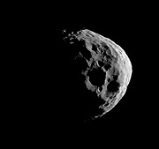 Shadows darken parts of some of Janus' large craters as Cassini takes a close look during its flyby of this Saturnian moon on March 27, 2012.