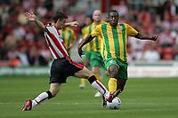 Photo: Lee Earle.<br /> Southampton v West Bromwich Albion. Coca Cola Championship. 12/08/2006. Saint's Chris Baird (L) battles with Nathan Ellington.