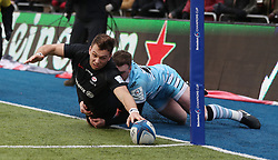 Saracens Alex Lewington is tackled into touch by Glasgow's Stuart Hogg during the Heineken European Challenge Cup, pool three match at Allianz Park, London.