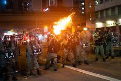 Hong Kong . 29 September 2019. Riot police fire tear gas towards protestors in Causeway Bay district of Hong Kong.