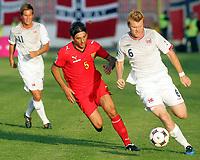 Fotball , 6. juni 2009 VM-kvalifisering , Norge - Makedonia<br /> John Arne Riise (r) Norway with Igor Mitreski (c) FYR Macedonia<br /> WC-qual.<br /> Norway - Macedonia