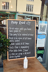 Covid information outside Fika cafe, Kingsbridge, Devon, October 2020