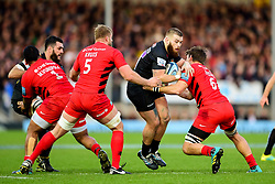 Luke Cowan Dickie of Exeter Chiefs is tackled by George Kruis of Saracens and Mike Rhodes of Saracens - Mandatory by-line: Ryan Hiscott/JMP - 22/12/2018 - RUGBY - Sandy Park - Exeter, England - Exeter Chiefs v Saracens - Gallagher Premiership Rugby