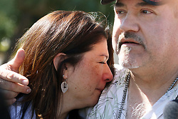 Las Vegas mass shooting survivors Johanna Ernst, left, of the San Francisco Bay area, and her boyfriend George Sanchez, of San Diego, are overcome with emotion while speaking to the news media on the Las Vegas Strip Tuesday, Oct. 3, 2017, in Las Vegas. Sanchez suffered a bullet wound to his left arm Sunday evening while the couple attended the Route 91 Harvest country music festival.